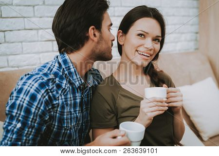Happy Man And Woman. Man With White Cup. Man Talking Woman. Family In Room. Smiling Family At Home.