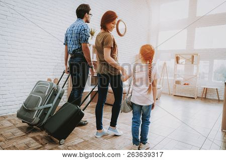 Happy Man And Woman. Family In Room. Smiling Family At Home. Smiling Person. Family With Child. New