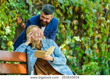 Couple In Love Romantic Date Nature Park Background. Girl Sit Bench Read Book While Wait Boyfriend.