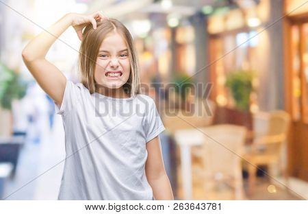 Young beautiful girl over isolated background confuse and wonder about question. Uncertain with doubt, thinking with hand on head. Pensive concept.