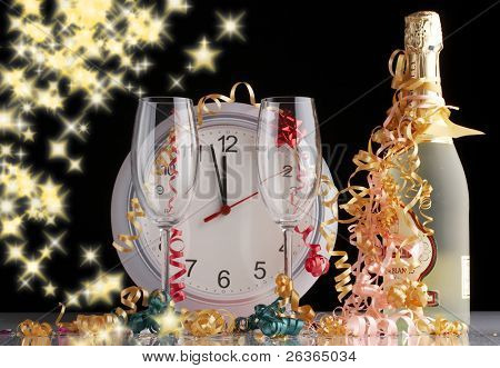 waiting the New Year with Champagne and empty bottles on black glittering background