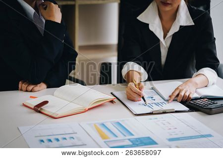Businesswoman Holding A Pen Pointing The Graph And Partnership To Analyze The Marketing Plan With Ca