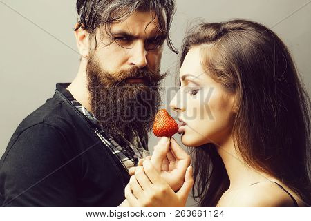 Young Sexy Couple Of Woman With Pretty Face And Brunette Hair With Bare Shoulders And Handsome Beard