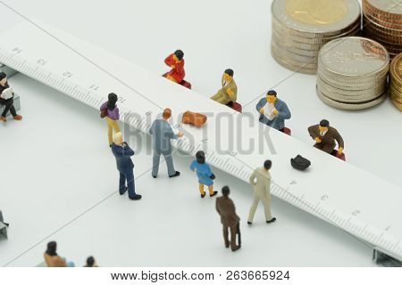 Miniature People Use Cash Deposit. At The Bank Counter Or Financial Institution. There Are Many User