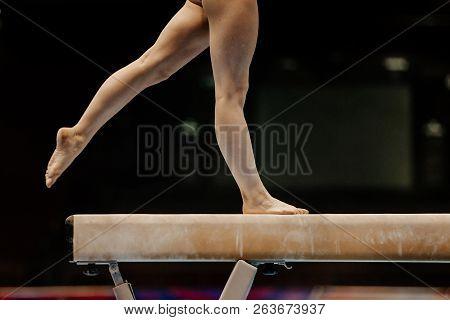 Legs Of Female Gymnast On Balance Beam Competition Gymnastics