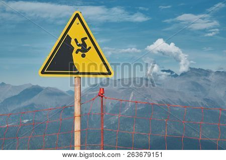 Mountain Danger Sign About Cliff Falling. Extreme Sports Danger Concept Photo