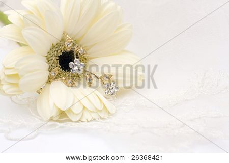 textile wedding background, flower and jewelry