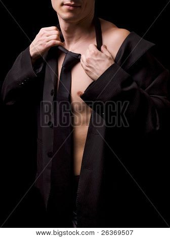 young male model posing in black shirt and tie