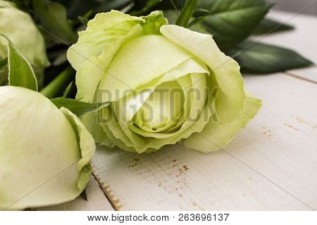Wedding Bouquet Of White Flowers On A Light Background. Wedding Flowers In Nature. Candles. Wedding