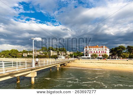 The Moulleau jetty and shore under a dramatic storm sky, Bassin d'Arcachon, Aquitaine, Gironde, France