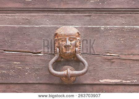 Specchia, Apulia, Italy - A Very Old Pharaoh Door Knob On A Wooden Door