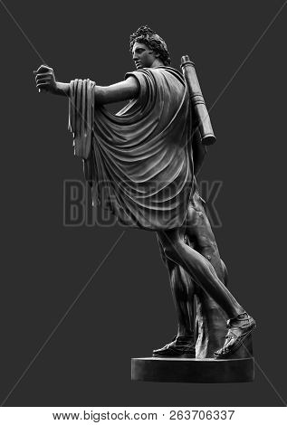 Bronze Statue Of Apollo Against Dark Grey Background. Apollo In Classical Greek And Roman Mythology