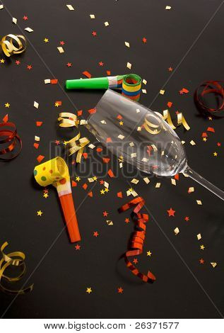 red and golden spirals, small confetti stars, blowers and flute , party time poster