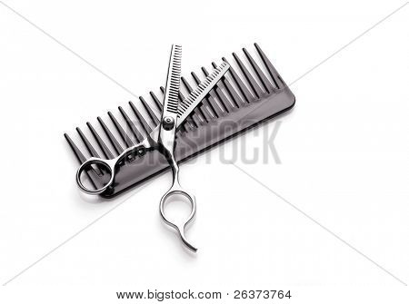 comb and scissors; hairstyling concept