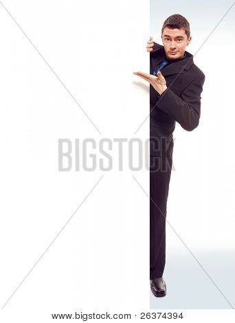happy man pointing to white blank card