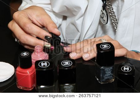 Woman Paints Nails With Nail Polish Chanel. Moscow. 24.07.2013