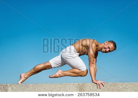 Man Practicing Yoga Blue Sky Background. Reached Peace Of Mind. Meditation And Yoga Concept. Yoga He