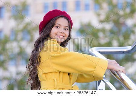 Kid Girl Bright Hat Beret. Autumn Hat Fashion Accessory. French Trend Fall Season. Girl Walk Defocus