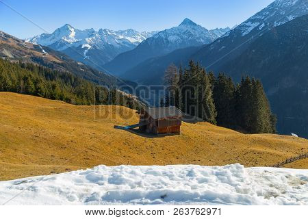 Mountain Landscape. Beautiful Winter Landscape. The Slopes Of The Alps With The Yellow Grass. The To
