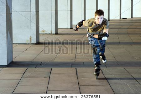 Roller skating at some building.