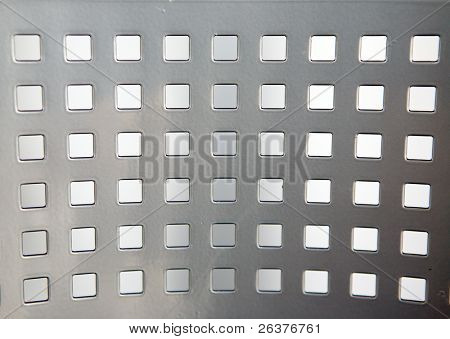 Metal with square holes. Modern background.