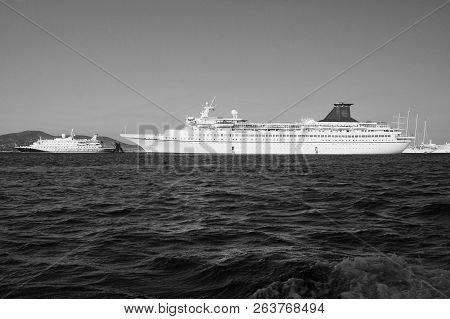 Patmos, Greece - April 19, 2010: Passenger Ships In Blue Sea. Cruise Ships Or Liners On Sunny Sky. C