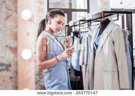 Designer Wearing Stylish Elegant Vest Feeling Unsure About Choosing Fabrics
