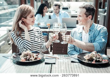 Happy Man Touching Bocals With His Woman