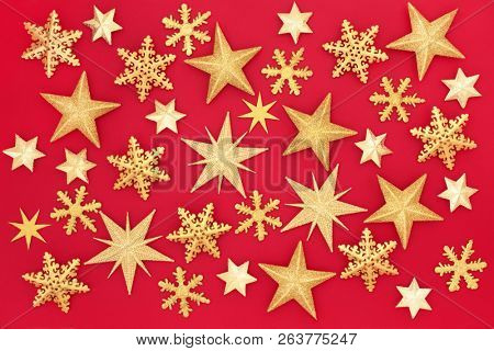 Christmas gold glitter star abstract background on red. Traditional Christmas greeting card for the festive season.