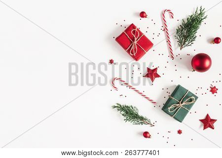Christmas Composition. Gifts, Fir Tree Branches, Red Decorations On White Background. Christmas, Win