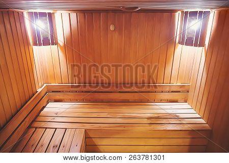Interior Of Small Home Finnish Wooden Sauna. Infrared Sauna. Cedar Bath. Benches In Hospital Recreat