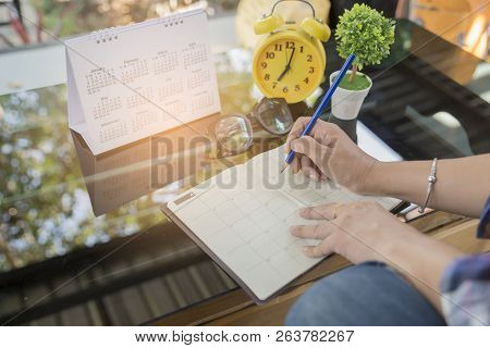 Calendar Reminder Event Concept.woman Hand Planner Or Organizer Writing On Diary Book And 2019 Calen