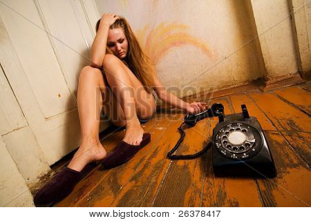 Woman crying after phone call.