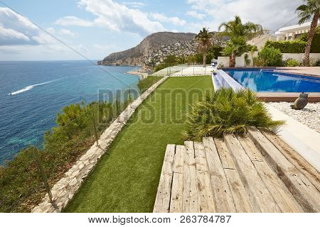 Spanish Mediterranean Coastline With Swimming Pool. Alicante. Summer In Spain