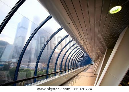Modern foot-bridge interior and beautiful view at high-rise buildings.