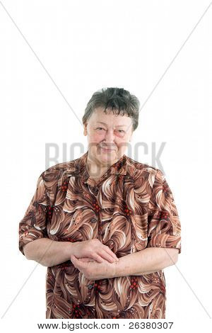 photo of an old woman standing and holding her hands together