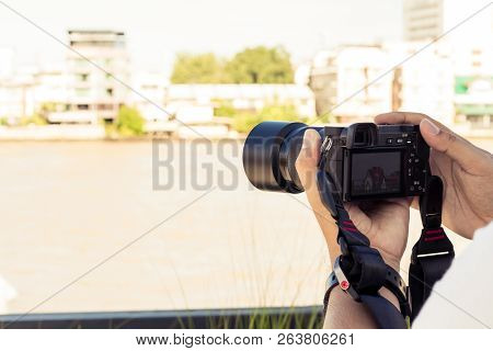 Hand Hold Digital Cameras And Photo Shoot Temple In Thailand. Camera Shooting A View Of The City Is