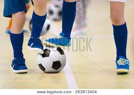 Indoor Futsal Soccer Players Playing Futsal Match. Indoor Soccer Sports Hall. Futsal Players Kicking