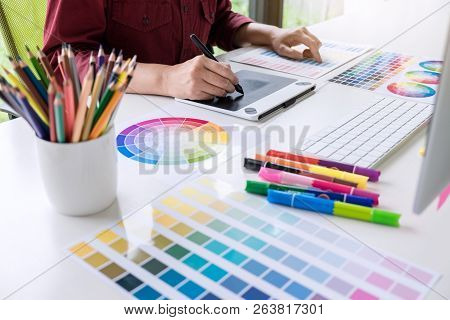 Image Of Female Creative Graphic Designer Working On Color Selection And Drawing On Graphics Tablet
