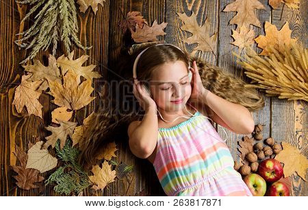 Child Listen Music Relaxing Top View. Fall Melody Concept. Fall Music Playlist. Best Songs About Fal