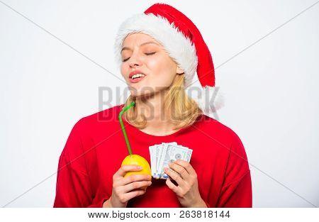 Girl Santa Hat Drink Juice Lemon While Hold Pile Money. Make Money On Fresh Lemonade. Christmas Prof
