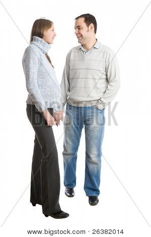 Happy family. Pregnant woman and her husband talking each other. isolated on white.