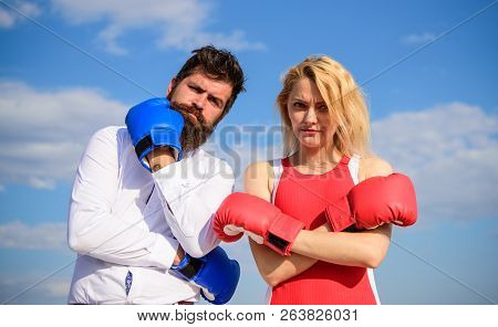 Marriage As Test Of Feelings. Stand For Your Point View. Couple In Love Boxing Gloves Sky Background