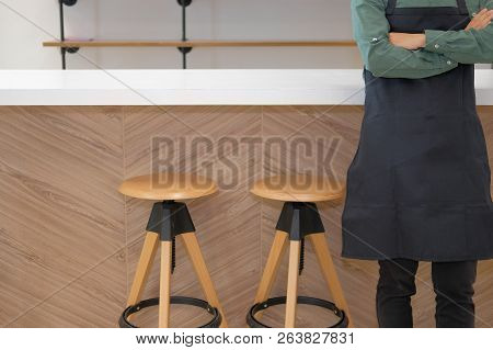 Business Owner Wearing Apron Holding Tablet At Counter Bar. Man Using Touchpad At Cafe Coffee Shop C