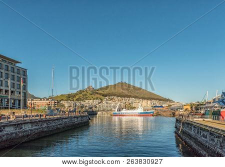 Cape Town, South Africa, August 9, 2018:  A Ship At The Entrance Of The Robinson Dry Dock At The Vic