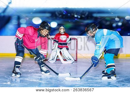 Young Hockey Defenseman In Action On Ice Rink