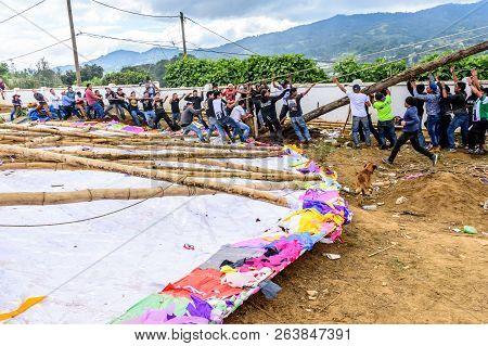 Santiago Sacatepequez, Guatemala - November 1, 2017: Men Raise Tree Trunk To Attach Giant Kite Uprig