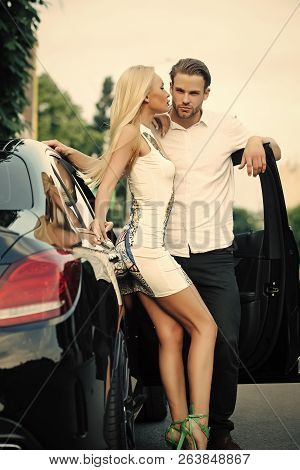 Sensual Woman And Man At Auto Outdoor. Sexy Couple At Car On Summer Day. Business Trip, Travel, Busi