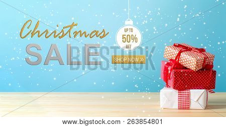 Christmas Sale Message With Christmas Gift Boxes With Red Ribbons