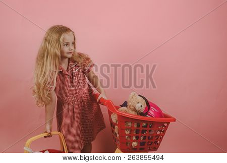 Retro Inspired. Little Shopaholic With Shopping Cart. Little Girl Shopping. Small Girl In Shop. Smal
